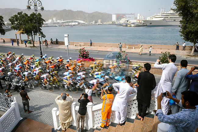 The peloton speed by during Stage 6 of the 10th Tour of Oman 2019, running 135.5km from Al Mouj Muscat to Matrah Corniche, Oman. 21st February 2019.<br /> Picture: ASO/P. Ballet | Cyclefile<br /> All photos usage must carry mandatory copyright credit (© Cyclefile | ASO/P. Ballet)