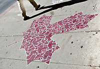 A man walks by a Maple leaf work of art on a Ottawa sidewalk Saturday September 25, 2010.<br /> <br /> PHOTO :  Francis Vachon - Agence Quebec Presse