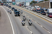An APD motorcycle motorcade escorts a hearse southbound through downtown on Interstate 35 during a funeral procession for Austin police officer Amir Abdul-Khaliq on Thursday September 8, 2016 - Stock Image.<br />