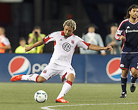 D.C. United midfielder Nick DeLeon (18) passes the ball.  In a Major League Soccer (MLS) match, the New England Revolution (blue) tied D.C. United (white), 0-0, at Gillette Stadium on June 8, 2013.