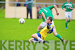 Classic FC's Damien Reid and Castleisland's Mike K McCarthy.