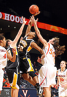 Dec. 18, 2010; Charlottesville, VA, USA; UMBC Retrievers guard Kristin Coles (22) reaches for the rebound with UMBC Retrievers 6-0 Meghan Colabella forward (10) and Virginia Cavaliers forward Chelsea Shine (50) during the game at the John Paul Jones Arena.  Mandatory Credit: Andrew Shurtleff