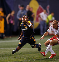 Los Angeles Galaxy forward (20) Carlos Pavon gets tripped up by New York Red Bulls midfielder (13) Clint Mathis during an MLS regular season match at Giants Stadium, East Rutherford, NJ, on August 18, 2007. The Red Bulls defeated the Galaxy 5-4.