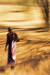 An African Masai tribesman walking with motion blur