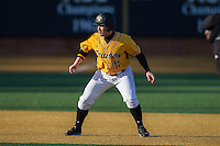 Kurt Wertz (17) of the Towson Tigers takes his lead off of second base against the Wake Forest Demon Deacons at Wake Forest Baseball Park on February 15, 2014 in Winston-Salem, North Carolina.  The Tigers defeated the Demon Deacons 5-4.  (Brian Westerholt/Four Seam Images)