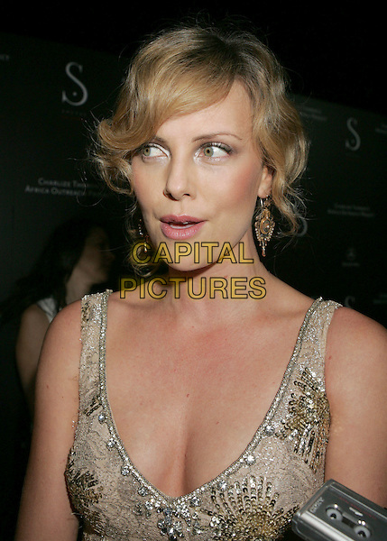 CHARLIZE THERON.Africa Outreach Program Benefit and Grand Opening of Social Hollywood at Social Hollywood, Hollywood, California, USA..June 27th, 2006.Photo: Russ Elliot/AdMedia/Capital Pictures.Ref: RE/ADM.headshot portrait cleavage jewel encrusted sequins.www.capitalpictures.com.sales@capitalpictures.com.© Capital Pictures.