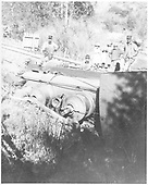 Top view of engine on its side in ditch.<br /> RGS