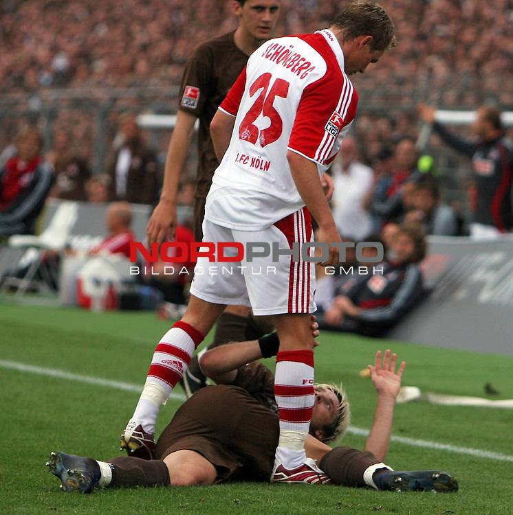 2.Liga 2007/2008  1. Spieltag Hinrunde<br /> FC St.Pauli &ndash; vs. 1.FC Koeln 0:2<br /> <br /> Koelns Verteidiger Kevin Schoeneberg (Nr.25) schaut auf Bjoern Brunnemann (Nr.5) runter, der am Boden liegt und ehrfuerchtig die Haende hoch hebt. Alle haben Angst vorm 1.FC Koeln.<br /> <br /> <br /> Foto &copy; nph (nordphoto)<br /> <br /> *** Local Caption ***