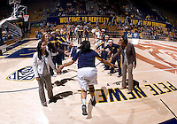 Justine Hartman of California slaps hands with coaches after being called before the game against Long Beach State at Haas Pavilion in Berkeley, California on November 8th, 2013.  California defeated Long Beach State, 70-51.
