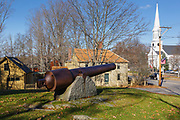 Emerson-Wilcox House behind cannon during the autumn months....located in York, Maine USA which is part of scenic New England