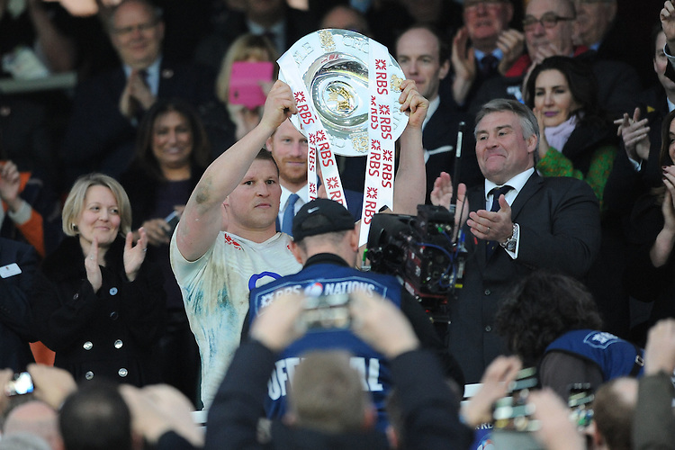The new England captain Dylan Hartley holds up the Triple Crown trophy after winning the RBS 6 Nations match between England and Wales at Twickenham Stadium on Saturday 12th March 2016 (Photo: Rob Munro/Stewart Communications)