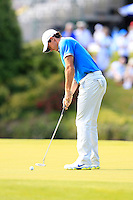 Rory McIlroy (NIR) takes his putt on the 18th green during Friday's Round 2 of the 2014 Irish Open held at Fota Island Resort, Cork, Ireland. 20th June 2014.<br /> Picture: Eoin Clarke www.golffile.ie