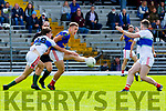 Dara Roche East Kerry gets his pass away under pressure from Brian O'Connor Dingle during the County Championship game in Fitzgerald Stadium on Sunday