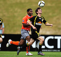 Wellington's Richard McLay controls the ball chased by Maurie Wasi..NZFC soccer  - Team Wellington v Waikato FC at Newtown Park, Wellington. Sunday, 20 December 2009. Photo: Dave Lintott/lintottphoto.co.nz