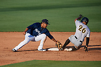 Lakeland Flying Tigers shortstop Isaac Paredes (3) puts the tag on Trae Arbet (26) as he slides into second base during the first game of a doubleheader against the Bradenton Marauders on April 11, 2018 at Publix Field at Joker Marchant Stadium in Lakeland, Florida.  Lakeland defeated Bradenton 5-4.  (Mike Janes/Four Seam Images)