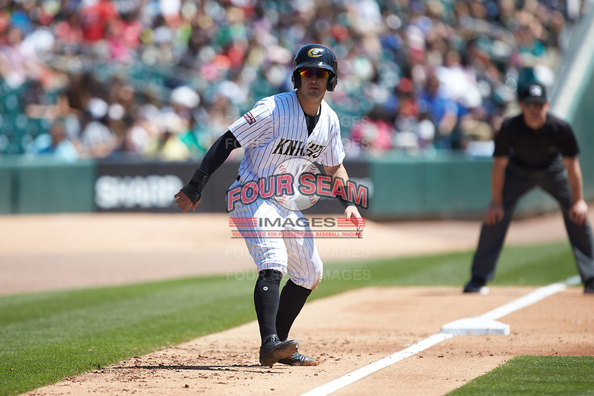 Eddy Alvarez (10) of the Charlotte Knights takes his lead off of third base against the Gwinnett Stripers at BB&T BallPark on May 2, 2018 in Charlotte, North Carolina.  The Knights defeated the Stripers 6-5.  (Brian Westerholt/Four Seam Images)