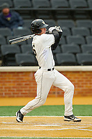 Brett Armour (6) of the Wake Forest Demon Deacons strokes a 2-out RBI single in the bottom of the second inning against the Western Carolina Catamounts at Wake Forest Baseball Park on March 26, 2013 in Winston-Salem, North Carolina.  The Demon Deacons defeated the Catamounts 3-1.  (Brian Westerholt/Four Seam Images)