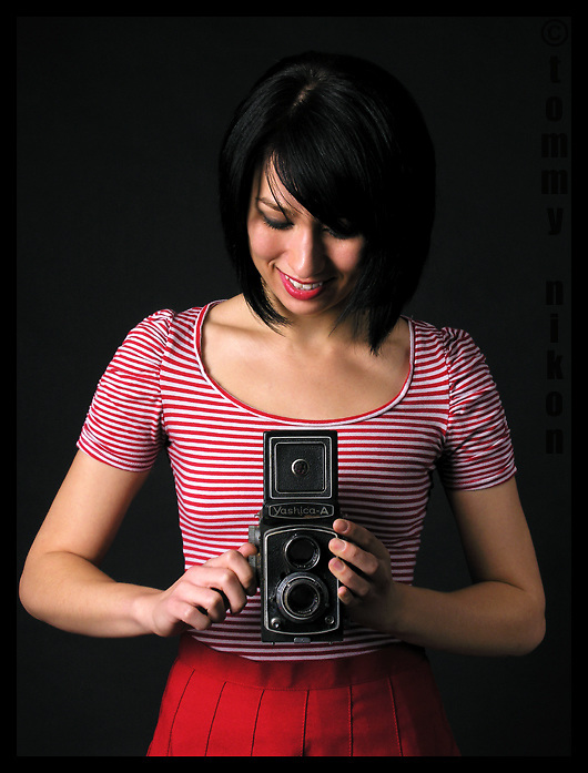 Martine the model with old twin lens reflex camera
