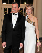 Robert Iger, President and CEO, Walt Disney Company, and his wife, Willow Bay, Senior Editor for the Huffington Post, arrive for the State Dinner in honor of President Hu Jintao of China at the White House In Washington, D.C. on Wednesday, January 19, 2011. .Credit: Ron Sachs / CNP