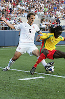 Steve Cherundolo (6) tries to take the ball from Jason James (right)during the First Round of the 2009 CONCACAF Gold Cup at Qwest Field in Seattle, Washington on July 4, 2009.