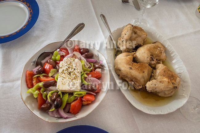 A Greek lunch of Greek salad with feta and roasted chicken, Trikala, Greece