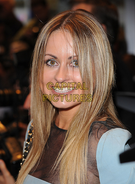 SARAH BARRAND .'The Kid'  UK premiere held at the Odeon West End, Leicester Square, London, England, 15th September 2010..portrait headshot grey gray mesh sheer see thru through smiling .CAP/BEL.©Tom Belcher/Capital Pictures.