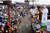 Szaflary, Poland March 3, 2011:.Two resin monuments of pope John Paul 2 for sale at the roadside shop, alongside with garden gnomes and other garden figures.. (Photo by Piotr Malecki / Napo Images)..Szaflary, 3/03/2011:.Dwie figury papieza Jana Pawla II zrobione z zywicy, na sprzedaz w przy droznym sklepie..Fot: Piotr Malecki / Napo Images