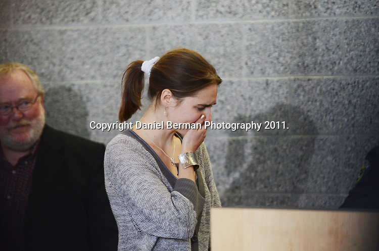 Amanda Knox is overcome with emotion as she acknowledges the waiting crowd and enormous media presence upon her arrival in the United States at Seattle-Tacoma International Airport in Seattle Tuesday, October 4. Knox's murder conviction was overturned by an Italian appellate court after spending four years in prison in Italy. Photo by Daniel Berman/www.bermanphotos.com