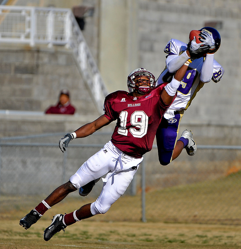 A&M defensive back Frank Moore (19) breaks up pass intended for Prairie View wide receiver Shaun Stephens (89) on third down in end zone to stop Prairie View drive.  Alabama A&M vs. Prairie View football  at Louis Crews Stadium.  Bob Gathany / The Huntsville TImes