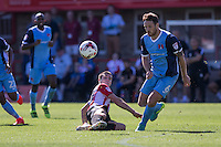 Dan Holman of Cheltenham wins the ball from Tom Parkes of Leyton Orient during the Sky Bet League 2 match between Cheltenham Town and Leyton Orient at the LCI Rail Stadium, Cheltenham, England on 6 August 2016. Photo by Mark  Hawkins / PRiME Media Images.