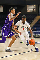 Washington, DC - December 22, 2018: Richmond Spiders forward Nathan Cayo (4) is being defended by a High Point Panthers player during the DC Hoops Fest between Hampton and Howard at  Entertainment and Sports Arena in Washington, DC.   (Photo by Elliott Brown/Media Images International)