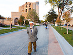 Uzbek man on Tachkent Kochasi, with Bibi khanum mosque in the background, Samarkand