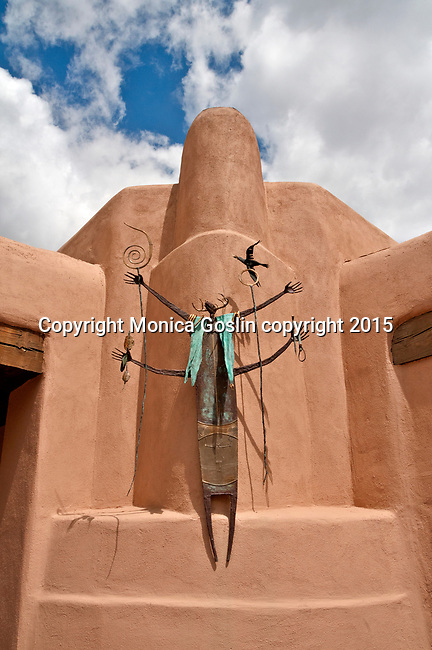 """Sculpture by Bill Worrell called """"Gift of Light"""" outside of Worrell Gallery on Washington Avenue downtown Santa Fe, New Mexico"""