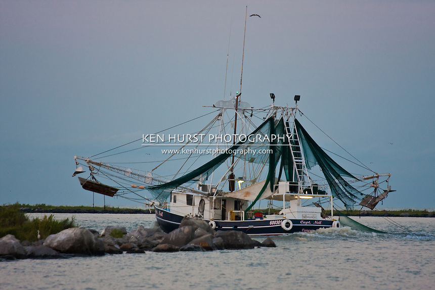 Shrimp trawler in Cameron, Louisiana heading out to sea.