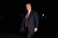 US President Donald J. Trump walks to the residence after stepping off Marine One on the South Lawn of the White House in Washington, DC, USA, 07 October 2017. President Trump traveled to  North Carolina for a pair of fund raising events<br /> CAP/MPI/POOL/ST<br /> &copy;ST/POOL/MPI/Capital Pictures
