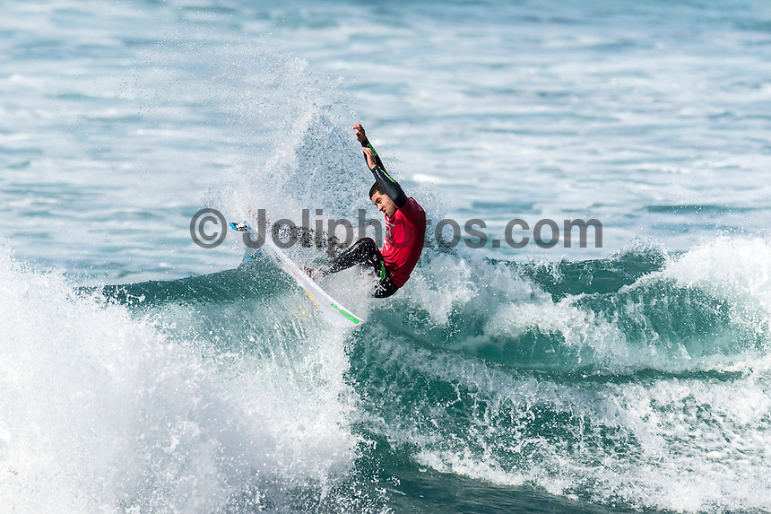 Bells Beach, Torquay, Victoria, Australia (Friday, March 25 2016): Adriano de Souza (BRA) - <br /> Round One of the Men's Rip Curl Pro hit the water at 8 am this morning and there were 6 heats run before the tide filled in and the event was called off for the day.<br /> There were light South West to North West winds through the morning with the swell in the 3'-4' range.<br /> <br /> Bells Beach has been hosting surfing tournaments for more than 50 years now, making it the most renowned spot on the raw and rugged southern coast of Victoria, Australia. The list of  Rip Curl Pro event champions is a veritable who's who of surfing icons, including many world champions.<br /> <br /> Surfing's greats have a way of dominating Bells. Mark Richards, Kelly Slater, and Mick Fanning all have four Bells trophies; Michael Peterson and Sunny Garcia, three; While Simon Anderson, Tom Curren, Joel Parkinson, Andy Irons, and Damien Hardman each grabbed a pair.<br /> <br /> The story is similar on the women's side. Lisa Andersen and Stephanie Gilmore have four Bells titles; Layne Beachley and Pauline Menczer, three; while Kim Mearig and Sally Fitzgibbons each have two.<br /> <br /> The 2016 event is about to kick off tomorrow and there was a packed warm up session at Bells this morning. <br /> Photo: joliphotos.com