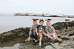 Craig, Rhys and Callum Shevlin at the Green Buoy 1KM Swim in Clogherhead....(Photo credit should read Jenny Matthews/NEWSFILE)...
