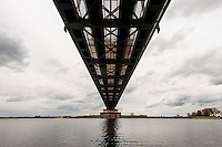 Nederland, Culemborg, 19 april 2012.Spoorbrug over de Lek, weerspiegeld in water...Foto(c): Michiel Wijnbergh