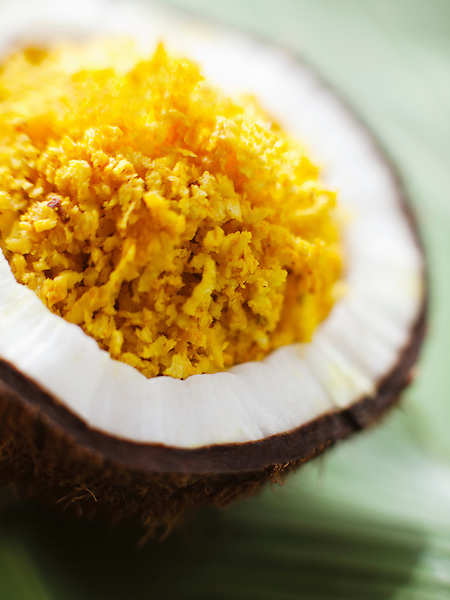 The coconut scrub is applied directly in a rubbing motion to exfoliate and smoothen the skin. Kairali Ayurvedic Health Resort, Palakkad, Kerala, India.