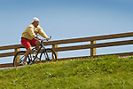 Williamsport River walk. Man cycling.