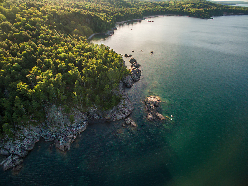 Aerial drone shot of stand up paddling on Lake Superior near Marquette, Michigan.