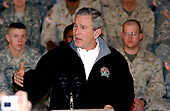 Bagram Air Force Base, Afghanistan - March 1, 2006 -- United States President George W. Bush speaks to a crowd of troops during a surprise visit to troops at Bagram Air Force Base, Afghanistan on March 1, 2006. Bush thanked the troops for their service and assured them they are making strides towards democracy in Afghanistan.<br /> Credit: Brian Schroeder - U.S. Army via CNP