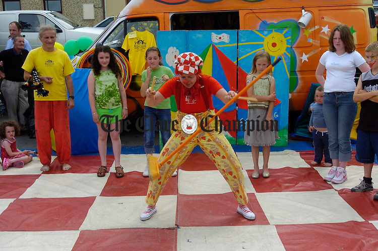 Pipa, the clown of the Galway Circus project shows how it's done during the street carnival in Ennis market on Sunday. Photograph by John Kelly.