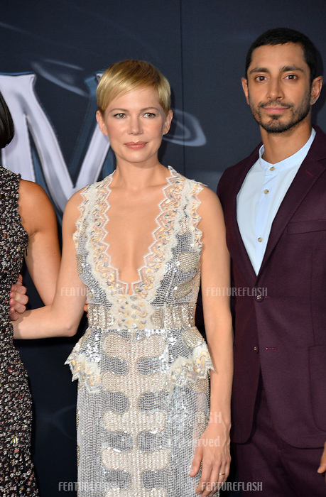 LOS ANGELES, CA. October 01, 2018: Michelle Lee &amp; Riz Ahmed at the world premiere for &quot;Venom&quot; at the Regency Village Theatre.<br /> Picture: Paul Smith/Featureflash