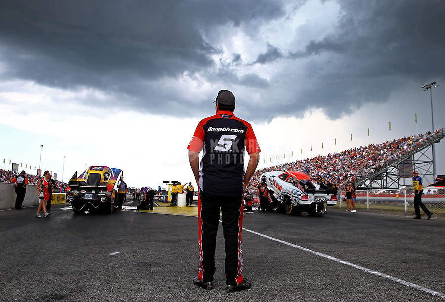 Aug. 31, 2013; Clermont, IN, USA: NHRA funny car driver Cruz Pedregon looks on during a rain delay to qualifying for the US Nationals at Lucas Oil Raceway. Mandatory Credit: Mark J. Rebilas-