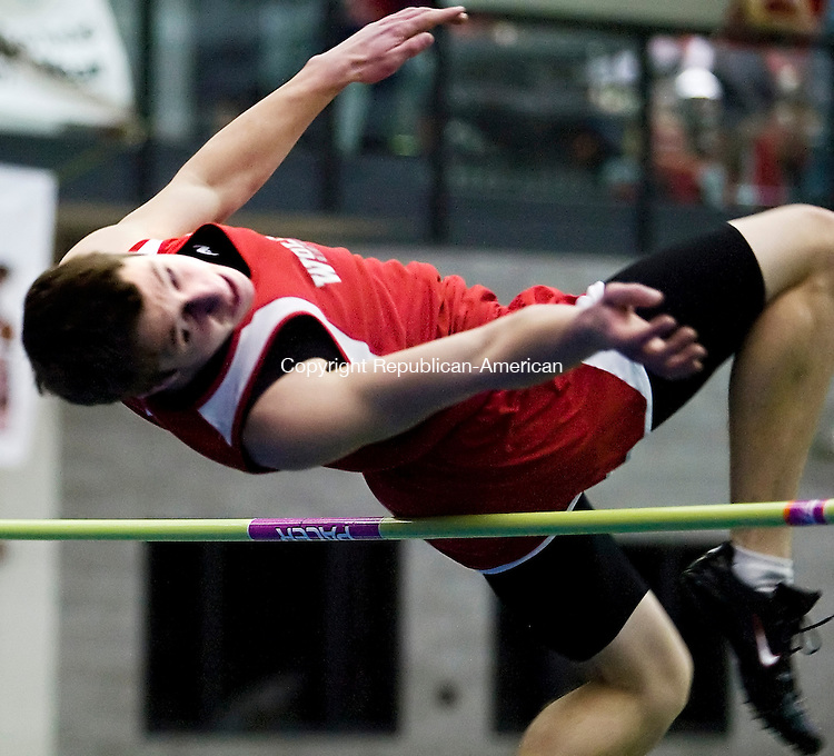 "NEW HAVEN--11 February 2008--021008TJ12 - Wolcott's Kyle Sherman cleared 5'8"" for second place in the high jump at the NVL Indoor Track Championships on Monday, Feburary 11, 2008. (Photo by T.J. Kirkpatrick/Republican-American)"