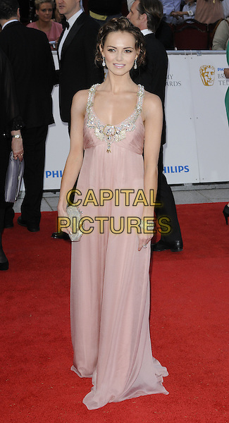 KARA TOINTON.The Philips British Academy Television Awards, Grosvenor house Hotel, Park Lane, London, England, UK, May 22nd 2011..arrivals TV Baftas Bafta full length pink maxi dress silver embellished beads beaded clutch bag.CAP/CAN.©Can Nguyen/Capital Pictures.