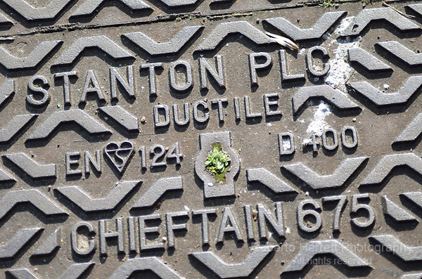 Stanton Plc manhole cover close-up.