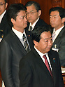 October 28, 2011, Tokyo, Japan - Japanese Prime Minister Yoshihiko Noda, right, is followed by Foreign Minister Koichiro Genba after Noda delivered his policy speech at a plenary session of the Diet's lower house in Tokyo on Friday, October 28, 2011. Noda stressed that the government is doing its utmost to cut costs in a bid to justify the tax burden needed to fund the 12.1 trillion yen disaster reconstruction budget. The prime minister also emphasized that hikes in income, corporate and local residential taxes are temporary and designed to cover what the government can't squeeze out of cost cuts and asset selling. (Photo by Natsuki Sakai/AFLO) [3615] -mis-
