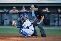 Burlington Royals catcher Nathan Esposito (7) sets a target as home plate umpire Mike Snover looks on during the game against the Princeton Rays at Burlington Athletic Stadium on June 24, 2016 in Burlington, North Carolina.  The Rays defeated the Royals 16-2.  (Brian Westerholt/Four Seam Images)